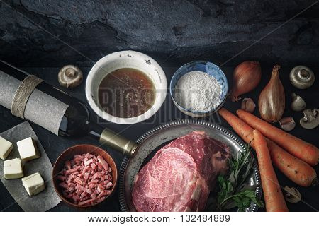 Ingredients for Boeuf Bourguignon on the dark stone table top view