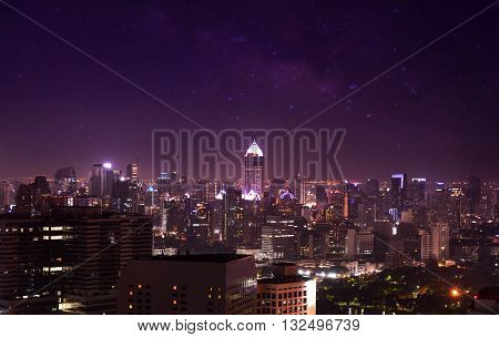 city view on night sky and milky way cityscape on twilight filter