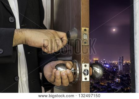 abstract concept of business man open the door to cityscape open mind unseen urban cityscape