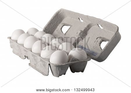 A carton of a dozen fresh eggs angled view