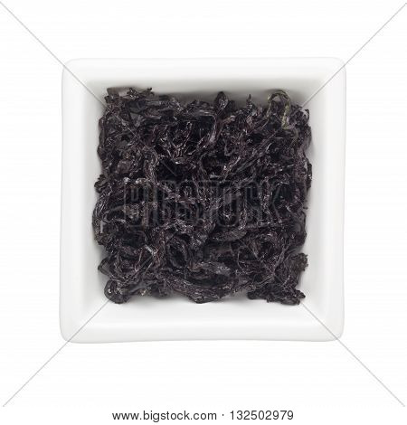 Black moss in a square bowl isolated on white background