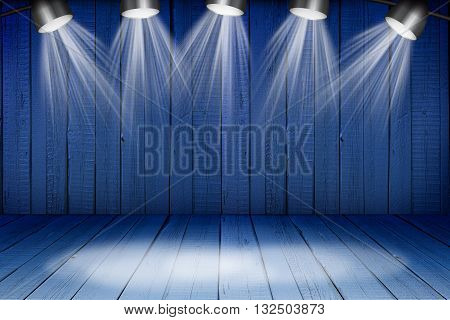 Illuminated empty blue concert stage with soffits