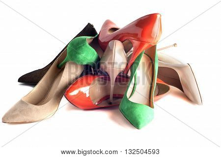 bright multicolored female shoes on high heels isolated on white background