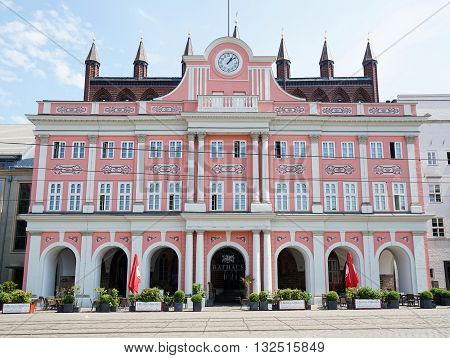Rostock, Germany - May 30th, 2016: The historic Rathaus city hall building, located at Neuer Markt, dates back to the 13th century.