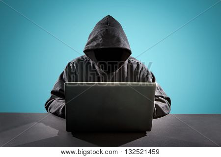 Hacker using laptop. Hacking the Internet - Stock Image.