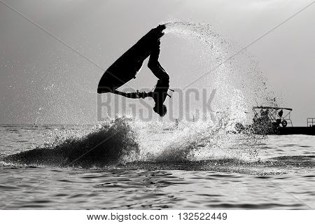 Silhouette picture, Jetski Freestyle back and white.