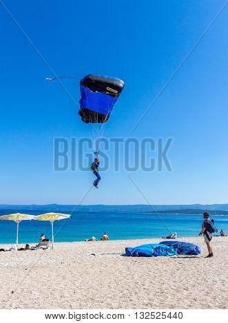 Brac Croatia - May 07 2016: Parachutist landing on Zlatni Rut beach