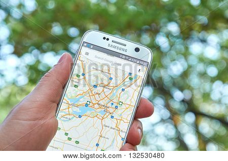 MONTREAL CANADA - MAY 23 2016 : Google Maps application on Samsung S7 screen. The Google Maps app is a popular gps navigation software.