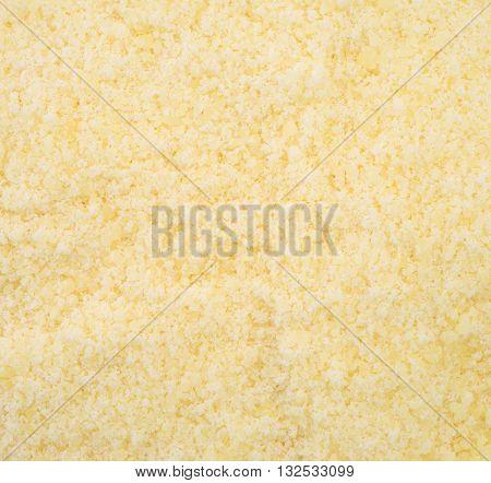 Very close view of grated Pecorino Romano cheese.
