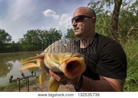 Carp and Fisherman, Carp fishing trophy Selective focus and shallow Depth of field