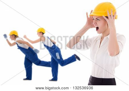 stress at work -business woman architect in yellow builder helmet shouting on workers isolated on white background