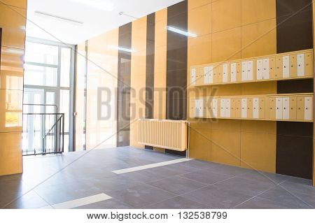 Entrance in a modern building with mailboxes