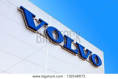 SAMARA RUSSIA - MAY 29 2016: Volvo dealership sign against the blue sky. Volvo is a Swedish multinational automaker company headquartered in Gothenburg Sweden