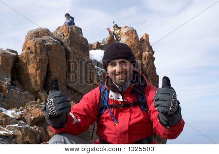 Happy Mountain Tourist On Cliff