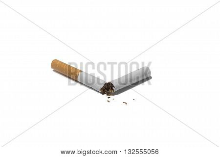 Broken cigarette with tobacco isolated on white background