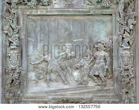 PISA, ITALY - JUNE 06, 2015: Flagellation of Jesus Christ, sculpture work panel from Giambologna's school, right portal panel of the Cathedral St. Mary of the Assumption, Pisa, Italy on June 06, 2015
