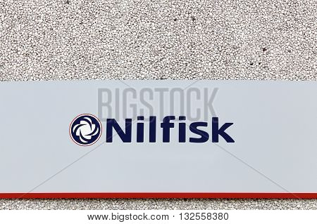 Haderslev, Denmark - May 29, 2016: Nilfisk sign on a wall. Nilfisk is a supplier of professional cleaning equipment in both industrial, commercial and consumer markets