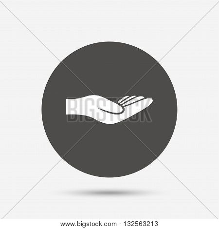 Donation hand sign icon. Charity or endowment symbol. Human helping hand palm. Gray circle button with icon. Vector