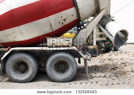 Cement mixer truck transport red and white tank