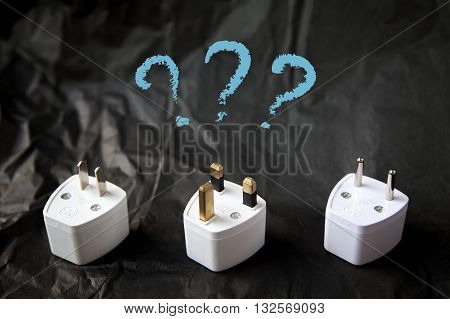 Choosing from various electric plug adapters. Difficulties and problems of traveling around the world. Black and white