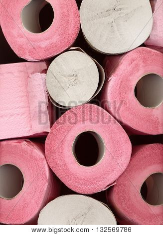 Different pink and gray toilet paper rolls close-up background macro pattern. Personal hygiene. Incontinence