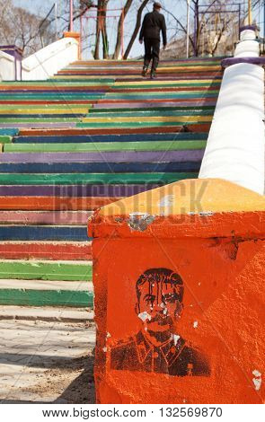 KHABAROVSK, RUSIIA - APRIL 18, 2014: Former USSR leader Joseph Stalin graffiti portrait. Colorful stairs in a park