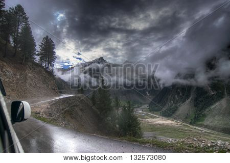storm clouds over mountains of ladakh Leh Srinagar Highway green valley scenary Jammu and Kashmir India. Rainy weather