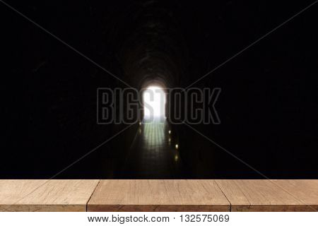 Wooden Table For Display Or Montage Your Product With Blur Background Of Light At The End Of Cave Tu