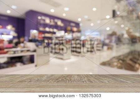 Wooden Table For Display Or Montage Your Product With Blur Background Of Shoes In Shopping Mall For