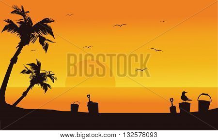 Bucket and shovel toy at summer silhouette in the beach