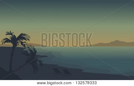 Silhouette of beach at summer holiday with fog at sunrise