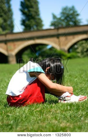 a young girl sulking outdoors on a lovely sunny day. poster