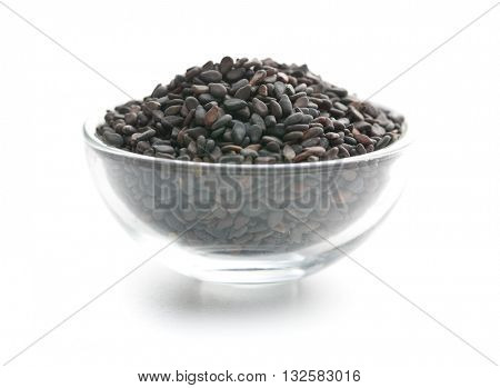 Black sesame seeds. Healthy sesame seeds in bowl  isolated on white background.