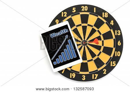 dart target in bullseye with graph of wealth on tablet screen over white background with copy space Goal target success wealth business investment financial strategy education concept abstract background
