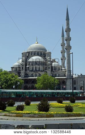 ISTANBUL TURKEY - JUNE 2 2016: The historic Yeni Cami Mosque dominating the water side of the old city of Istanbul Turkey on a sunny afternoon in June.