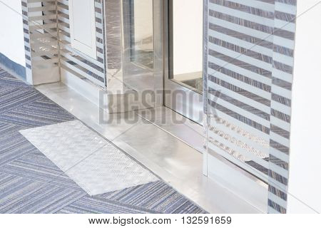 Safety step sign in front of lift door stock photo