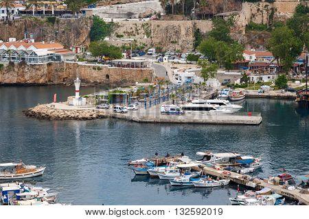 ANTALYA TURKEY - APRIL 24 2016 : View of Antalya Marina with boats ships and yatches on the coast.