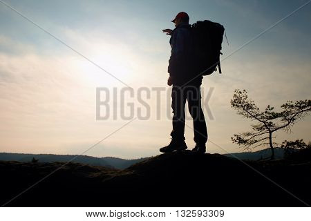 Man With Big Backpack Stand On Rock. Sunny Spring Daybreak