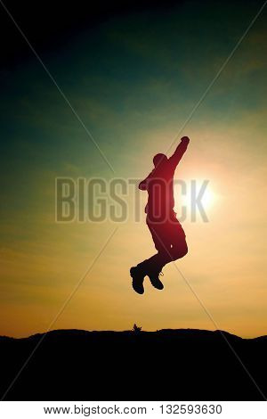 Jumping Man. Young Crazy  Man Is Jumping On Colorful Sky Background.silhouette Of Jumping Man And Be