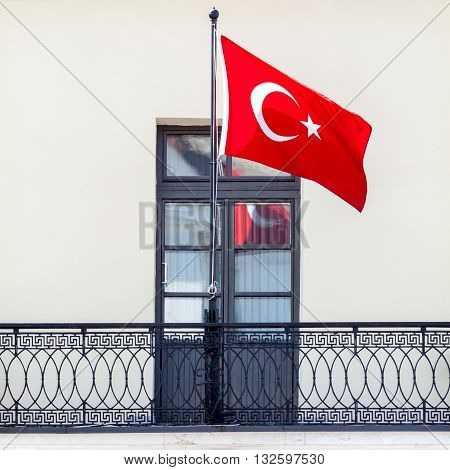 Turkish national flag waving in the wind on the balcony
