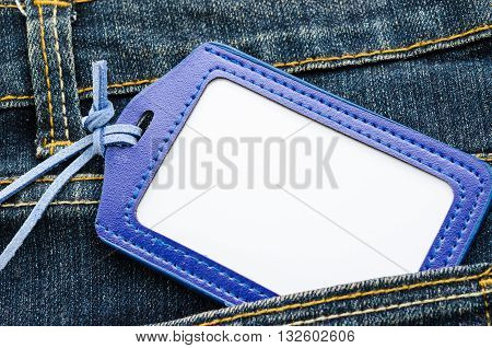Blank leather name tag on blue jean ready for your text or message.