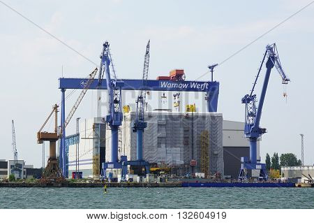 Rostock, Germany - May 30th, 2016: Warnow Werft shipbuilding wharf on river Warnow in Rostock Warnemunde.