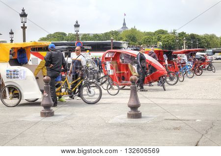 PARIS FRANCE - April 30.2014: Trishaw waiting of customers on the Place de la Concorde