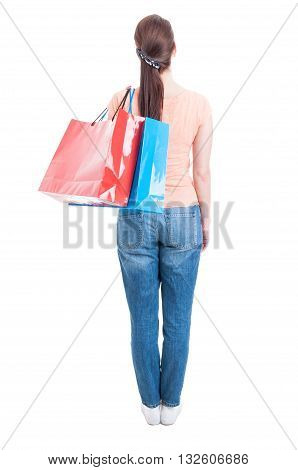 Backview Of Woman Standing And Carrying Shopping Bags On Shoulder