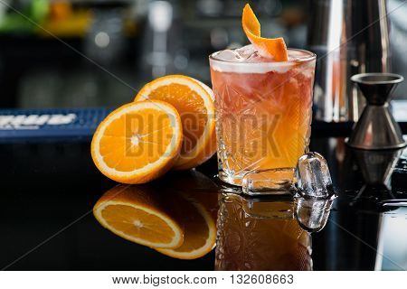 Fresh cocktail with orange and ice. Alcoholic non-alcoholic drink-beverage at the bar counter in the night club.