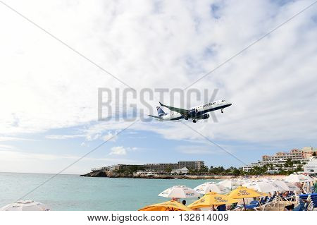 Plane Above Beach Water