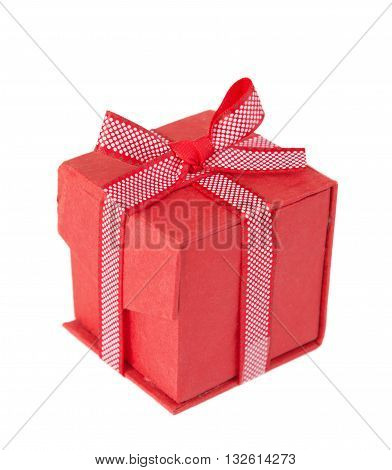 Red gift box tied with a decorative ribbon with polka dots with bow isolated on a white background