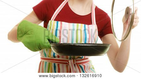Happy housewife or chef in colorful kitchen apron with skillet frying pan isolated studio shot