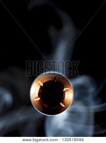 Copper jacketed bullet with a hollow point and smoke behind