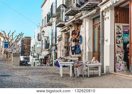 Peniscola Spain- March 03 2016: Souvenir shops in old town of Peniscola. Costa del Azahar province of Castellon Valencian Community. It is a popular tourist destination in Spain